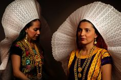 Zapotec Indigenous women from Tehuantepec wearing their traditional headdress. The Tehuana-style of clothes was popularized by Mexican icon Frida Kahlo. Location: Tehuantepec, Oaxaca, Mexico Photographer: Diego Huerta