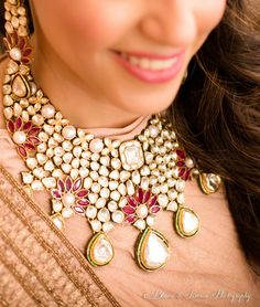 Indian Wedding Jewelry - Beautiful Polki Necklace with Ruby Flowers and Pearls | WedMeGood | #indianjewelry #jewelry #necklace #bridal #polki #indianbride #indianwedding