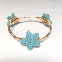 Blue lava rock star fish bangle Blue lava rock star fish beads on gold wire, 7 1/2 inches around (size can be customized per request) Immeasurably More Jewelry Bracelets