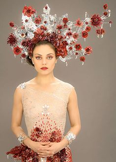 Mila Kunis (Jupiter Jones) in her floral wedding headdress in Jupiter Ascending.