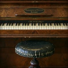 Lovely vintage piano and leather seat.reminds me so much of our piano.I took lessons for years.loved every minute of it! Old West, Touches De Piano, Beth Greene, Old Pianos, Over The Garden Wall, Sound Of Music, Bates Motel, The Dreamers, Old Things