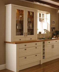 Burford Gloss Cream - Burford - Kitchen Families - Kitchen Collection - Howdens Joinery Cabinet and drawers (with solid doors? Loft Kitchen, Small Kitchen Storage, Family Kitchen, Green Kitchen, Kitchen Living, Beige Kitchen, Kitchen Dresser, Kitchen Furniture, Kitchen Cabinets