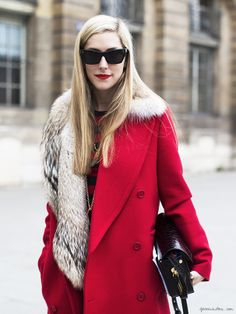 Joanna Hillman, red trench coat, fur collar, striped sweater, sunglasses, red lips / Garance Doré