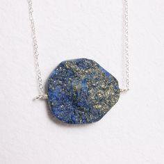 Raw Stone Jewelry Blue Lapis and Pyrite Pendant Necklace Rough Semi Precious Stone Silver Chain. $33.00, via Etsy.