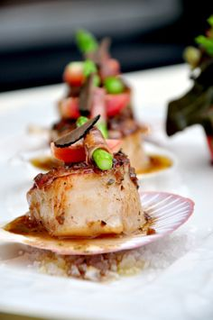 Roasted Japanese Scallops Marinated with Lemoncello, Asparagus with Parma Ham and Black Olive Sauce