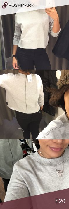 H&M zipper on back cropped sweatshirt in grey Hi! For sale is an h&m cropped sweatshirt. Worn twice and machine washed after.  Back zips up and off H&M Tops Sweatshirts & Hoodies