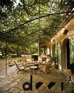 """#HisRoyalHotness and I FINALLY decided on a Spanish Villa feel for our outdoor living space. Not entirely sure what to do about Fernando's wrought iron """"deer"""" art installment. Artists. I don't get it. #MyImaginaryBrentwoodLife"""