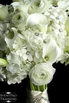 All white fresh flower bouquet - ranunculus flowers, white hydrangea, white mini callas, and white stephanotis with bling jewel centers