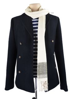 Originally worn by sailors, pea coats have turned into a classic must have for the season Luxire Wool Peacoat is one such example. The traditional silk scarf compliments the style and is up for sale: http://custom.luxire.com/products/luxire-wool-peacoat