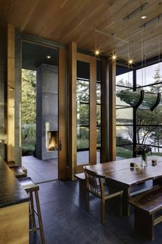 Minimalist  Decor. i like the wood doors & windows & ceiling; also the tall wall heights; earthy feel, e.g. Pacific Northwest style