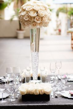 Tall Centerpiece #glass #ivory #roses
