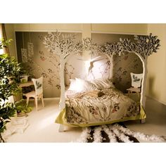 Under the apple tree canopy bed - minus the animal skull and the feathered boas on the floor.  And those ugly chairs in the corners.  Basically, just the bed then.