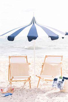 Bold stripe beach towels and umbrella on beach and wooden chairs Beach Day, Palm Beach, Summer Beach, Summer Fun, Summer Time, Outdoor Garden Furniture, Outdoor Decor, Mallorca Beaches, Beach Essentials