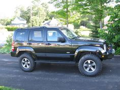 2008 LIBERTY with 3in. LIFT and 285-75-16's, CUSTOM SKIDS AND BUMPERS