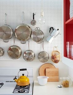 Pegboards in the Kitchen And I want hanging light fixtures like that.