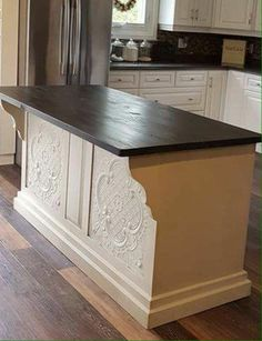 Ceiling tiles painted to add texture and style on kitchen island