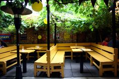 outside | yellow | benches | restaurant