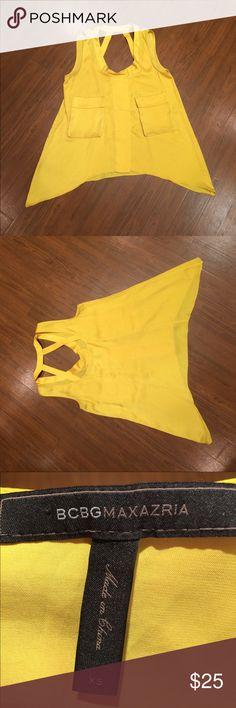 BCBGMaxAzria silky sleeveless shirt BCBGMaxAzria yellow silky sleeveless shirt with pockets on the front & cutouts on the back. Size X Small BCBGMaxAzria Tops Tank Tops