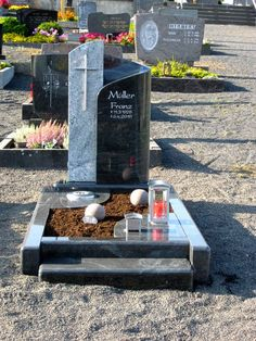 Full grave ledgers are memorials that are a slab of granite that is placed over the full grave. Small rock gardens or edgings with plantings surround many ledgers.add small steps like so Cemetery Headstones, Betta, Funeral, Granite, Outdoor Decor, Diy, Celebrity, Gardens, Monuments
