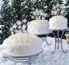 Pretty white snowflake cakes.