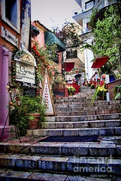 Taormina Steps Sicily. A beautiful medieval scene with muted pastel colors and beautiful archtecture
