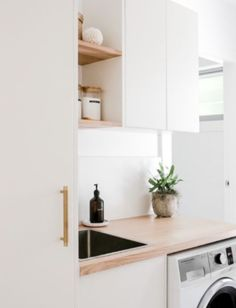 Looking for a project to keep you busy at home? Why not give your laundry that much needed update? @theurbanquarters used our antique white doors in the modern profile and our natural timber hevea benchtops to create this laundry space worth crushing over! . . . #kaboodle #kaboodlekitchen #kaboodlelaundry #laundrylove #laundryideas #interiorsinspo #designideas