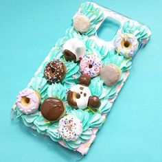 Did you know I make custom cases for any handheld device? Visit my website to find out how.  #panda #cabochon #decoden #resin #chocolate #donut #confetti #catscatscats #krispycream #whippedcream #sprinkledonut #cakeicing #phonecase #sugarcookie #polymerclay #スイーツデコ #teal #sweetsdeco #cakemaking #neko #mint #icing #frosting #bakery #アイシングクッキー #クッキー #kawaii #kawaiicase #cakeart #foodart