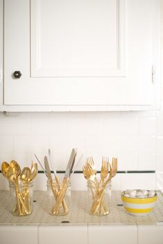 It's true: you can spray paint forks, spoons, and knives the safe way for an unexpectedly cool effect.  Photo by Bryce Covey Photography via Style Me Pretty