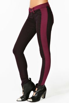 Totally rad plum skinny jeans featuring wine-hued side stripes. Faux front pockets, functional back pockets. Button/zip closure, stretch fabric. Looks awesome with an oversized knit and combat boots!