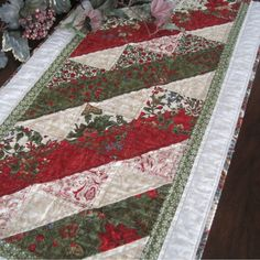 Holiday table runner with red and green Moda fabrics, machine pieced and quilted. $40.00, via Etsy.