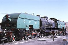 Caminhos de Ferro de Mozambique 951 class #960 (Haine St. Pierre 2068/1952) was overhauled by ZECO in Bulawayo, Zimbabwe in 1987 and worked until the early 1990's. It is pictured at Bulawayo in 1987 after overhaul but before return to Mozambique