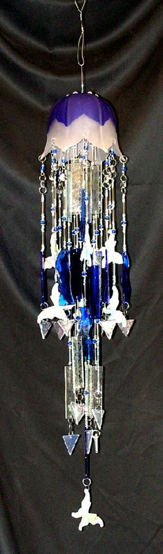 Butterflies and tulips in blue wind chime