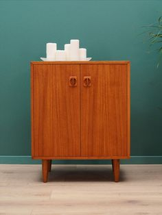 Phenomenal cabinet from the 60 / Danish design, minimalist form. Furniture finished with teak veneer. Cabinet has a drawer and a shelf behind a sliding door. Preserved in good condition (minor bruises and scratches) - directly for use. A Shelf, Shelves, Danish Design, Dressers, Sliding Doors, Teak, Drawer, Cabinets, Minimalist