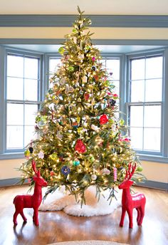 Young House Love Blog - use small Sherpa rugs from IKEA as a tree skirt.
