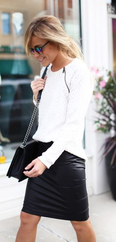 Mary Seng is wearing a white jumper from Vince, leather skirt from Helmut Lang and the bag is from Chanel