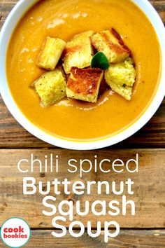Chili spices give a bold flavor to this butternut squash soup! Pan fried croutons tossed with fresh sage creat a hearty and homestyle soup dish everyone will enjoy! #cookbookies #butternutsquashsoup #soup #chili #butternutsoup #croutons #souprecipes