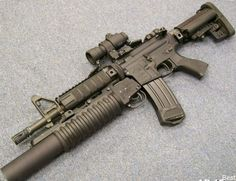 AR-15 with a CCO, and (civilian) M203 attachm