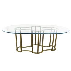 this is exactly like my grandmothers!!!  you sure i should sell it right??   Oval Glass & Brass Dining Table by Mastercraft | From a unique collection of antique and modern dining room tables at https://www.1stdibs.com/furniture/tables/dining-room-tables/