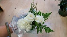 Basic white and silver corsage design with roses and mini carnations