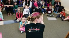 Marry Ellen doing a storytime wearing her awesome 100th Anniversary t-shirt!