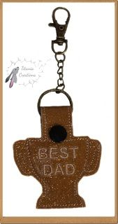 """Best Dad Trophy Key Fob.  There is a single fob in the 4x4 size and three colour sorted in the 5x7.  Each Fob is 2.24 x 3.86"""" with 2086 stitches.  You will receive one file containing DST, EXP, HUS, XXX, VIP, VP3, JEF, PES formats and full instructions."""