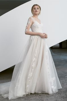 Adriel is a 1/2 sleeve wedding dress flowing with a floral applique down a soft tulle skirt. Arriving soon. Set up an appiontment on our site. Wedding Gowns With Sleeves, Wedding Dresses, Thing 1, A Line Gown, Bridal Boutique, Bridal Gowns, Ball Gowns, Dream Wedding, Wedding Shit