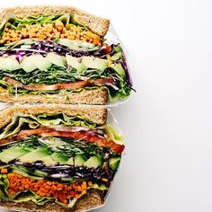 the ultimate veggie sandwich: lettuce, tomatoes, red onions, sprouts, avocado, red cabbage, and carrots. recipe and a shun knife and boos block give away, up on the blog  inspired by @lenwich!