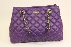 Everything is coming up violets with this Kate Spade Maryanne Gold Coast Deep African Violet handbag. Can be found at (www.handbagconsignmentshop.com)