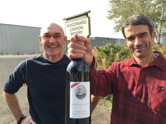 Owner Rick Small, left, and winemaker Kevin Mott display a bottle of the Woodward Canyon Winery 2012 Old Vines cabernet sauvignon at the winery in Lowden. (Andy Perdue)