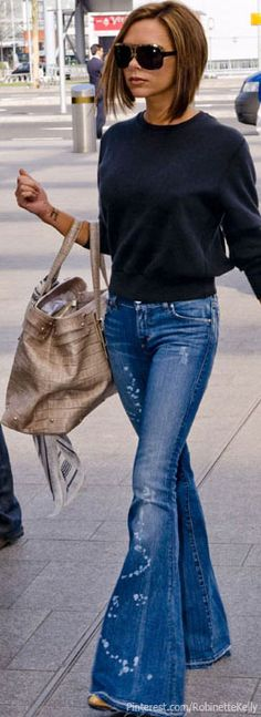 Denim Street Style | Victoria Beckham. I don't know how old this picture is but I'm glad to see her wearing flared jeans.  I just can't seem to let them go!