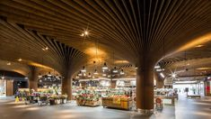 koichi takada architects' east village project in sydney features an urban marketplace under a timber, forest canopy. Australian Interior Design, Interior Design Awards, Interior Work, Australian Architecture, Retail Interior, Design Interiors, Bilbao, Vibe Hotel, Architects Sydney