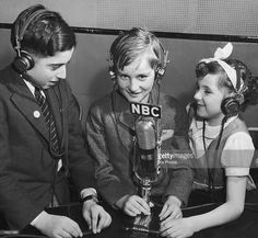 From left to right, young refugees Dennis Collins, John Fenn and Doreen Davenport speak to their parents back in England from the NBC Radio City Studios in New York during World War II, 9th February 1941.
