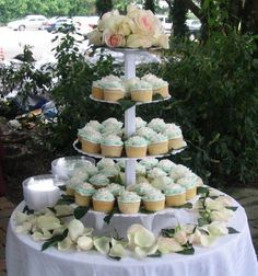 42 cupcakes each decorated with a single buttercream rose. I used the tall tier stand and decorated with fresh roses and leaves.