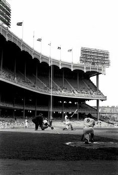 Classic #yankeestadium image. Roger Maris on deck with probably #themick at bat. #yankees